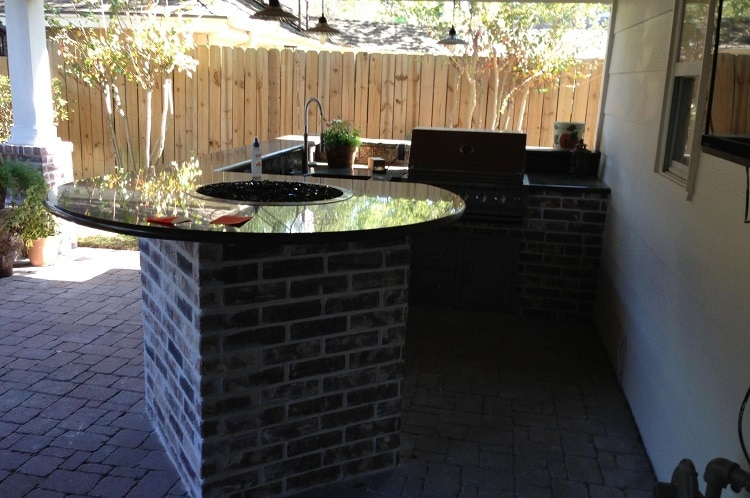 Fire table in an outdoor kitchen built with bricks